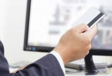 Crestere cu 40% a tranzactiilor cu carduri bancare online