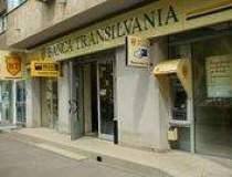 Banca Transilvania coboara...