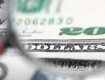 Dolarul ajunge la minimul...