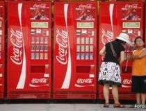 Profitul Coca-Cola din T2 a...