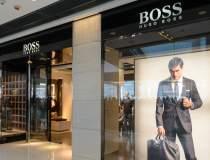 Hugo Boss va deschide patru...