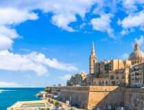 Malta plătește pentru...