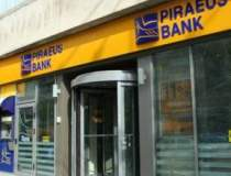 Piraeus Bank, mai putine...
