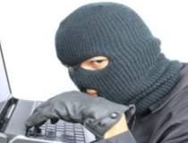Criminalitatea informatica,...