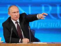 Craciunul in Rusia: Putin a...