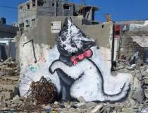 Banksy duce arta graffiti in...
