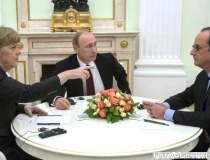 Hollande si Merkel au...