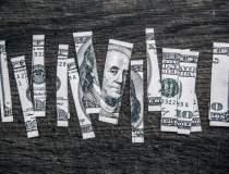 Cresterea dolarului reduce cu...