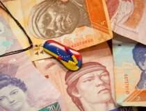 Venezuela reduce programul de...