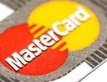 UE acuza MasterCard de...