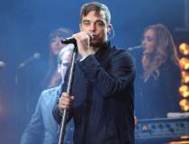 Robbie Williams a plecat din...