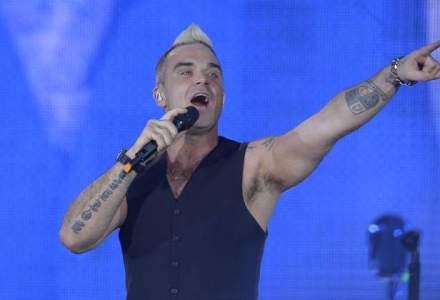 """Robbie Williams a """"descoperit"""" ca e iubit in Romania si le-a oferit fanilor un show de neuitat"""