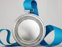 Zece premii pentru olimpicii...