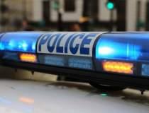 Un politist a fost lovit cu...