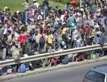 Peste 13.000 de imigranti au...