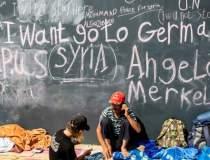 Refugiatii, imbracati in...