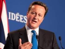 Premierul David Cameron, in...