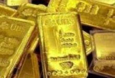 Aurul a atins un nou pret record pe fondul deprecierii dolarului