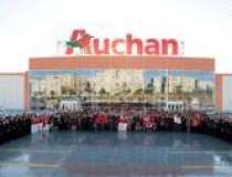 Auchan negociaza cu Bel Rom...