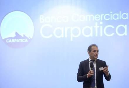 Banca Carpatica si-a redus anul trecut pierderea la jumatate, dar au scazut si activele cu aproape 5%