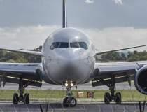 Un avion cu 300 pasageri a...